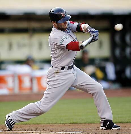Boston Red Sox's Dustin Pedroia connects for an RBI single off Oakland Athletics' Jarrod Parker in the first inning of a baseball game, Monday, July 2, 2012, in San Francisco. (AP Photo/Ben Margot) Photo: Ben Margot, Associated Press