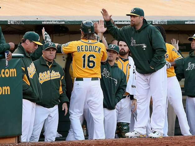 OAKLAND, CA - JULY 02:  Josh Reddick #16 of the Oakland Athletics is congratulated by teammates after he hit a sacrifice fly that score Brandon Inge #7 of the Oakland Athletics in the second inning of their game against the Boston Red Sox at O.co Coliseum on July 2, 2012 in Oakland, California.  (Photo by Ezra Shaw/Getty Images) Photo: Ezra Shaw, Getty Images