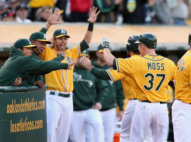 OAKLAND, CA - JULY 02:  Brandon Moss #37 of the Oakland Athletics is congratulated by teammates after he hit a three run home run in the second inning of their game against the Boston Red Sox at O.co Coliseum on July 2, 2012 in Oakland, California.  (Photo by Ezra Shaw/Getty Images) Photo: Ezra Shaw, Getty Images