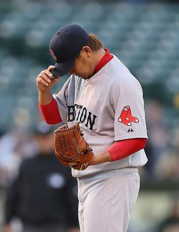 OAKLAND, CA - JULY 02:  Daisuke Matsuzaka #18 of the Boston Red Sox adjusts his hat after giving up a home run to Josh Reddick #16 of the Oakland Athletics at O.co Coliseum on July 2, 2012 in Oakland, California.  (Photo by Ezra Shaw/Getty Images) Photo: Ezra Shaw, Getty Images