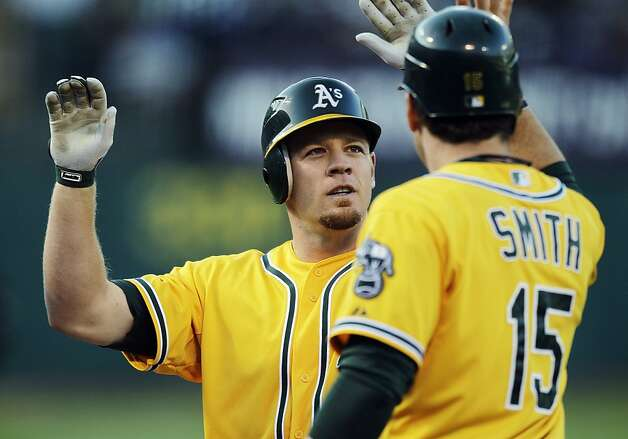 Oakland Athletics' Brandon Moss, left, is congratulated by Seth Smith (15) after Moss hit a three-run home run off Boston Red Sox's Daisuke Matsuzaka in the second inning of a baseball game, Monday, July 2, 2012, in San Francisco. (AP Photo/Ben Margot) Photo: Ben Margot, Associated Press