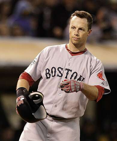 Boston Red Sox's Daniel Nava tosses his helmet after striking out to Oakland Athletics' Sean Doolittle in the seventh inning of a baseball game Monday, July 2, 2012, in San Francisco. (AP Photo/Ben Margot) Photo: Ben Margot, Associated Press