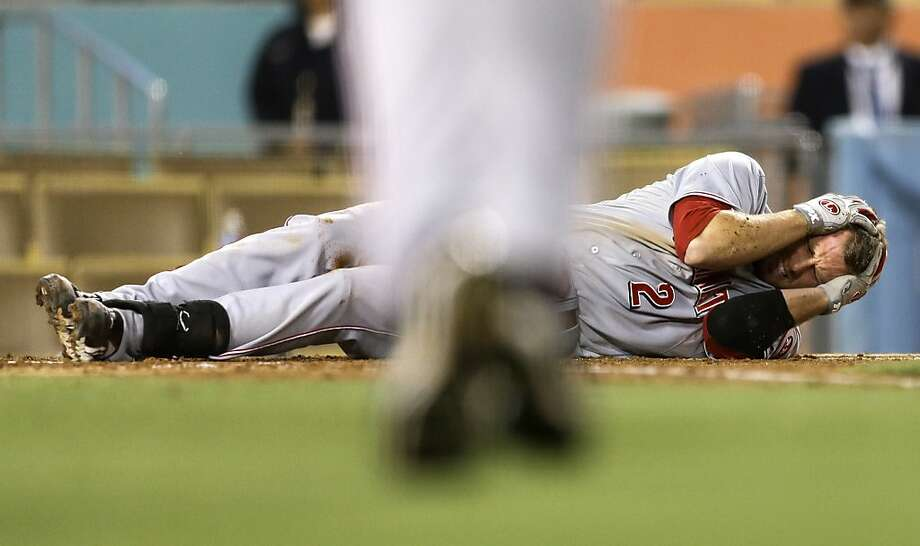 Cincinnati Reds' Zack Cozart rolls on the ground after getting hit by a pitch during the fifth inning of a baseball game against the Los Angeles Dodgers in Los Angeles, Monday, July 2, 2012. (AP Photo/Chris Carlson) Photo: Chris Carlson, Associated Press