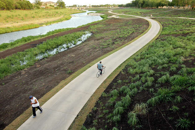 People use the new section of the Mission Reach Ecosystem Restoration and Recreation Project of the San Antonio River Monday, July 2, 2012. Photo: Edward A. Ornelas, San Antonio Express-News / © 2012 San Antonio Express-News