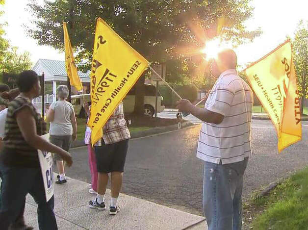 District 1199 health care workers picket outside West River Health Care Center on Orange Ave. in Milford, Conn. July 3, 2012. Photo: WTNH News 8