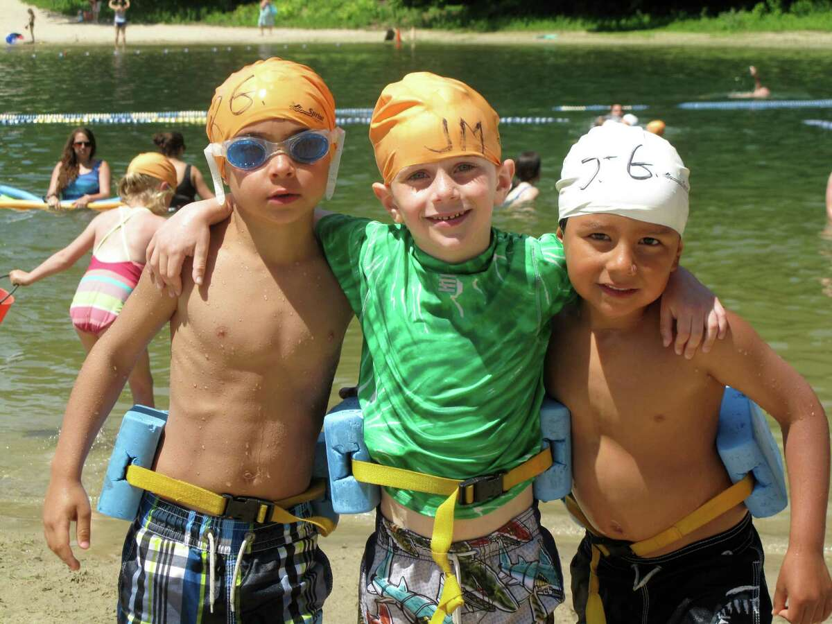 Ryan Girlamo, 5, Jacob Molaver, 6, and Jacob Kazzer, 5, enjoy a refreshing swim in the pond at Kiwanis Park Monday, July 2, 2012. The boys are campers at the YMCA's Camp Y-Ki. Photo by Ian Brash, New Canaan, Conn.