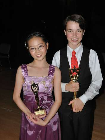 "Two young music students proved their talent by taking home the top two awards at the Darien Arts Centerís Darienís Got Talent fund raiser on Saturday night in front of a sold out audience at the Darien Town Hall Auditorium. Teresa Du, a piano student at the DAC, and a seventh grade student at Middlesex Middle School, placed second performing Chopinís ""Nocturne in C Sharp Minor."" Christopher Jessup, a student at New Canaan Country School, took first place for performing an original composition titled ""Concerto in Three Keys."" Photo: Contributed Photo"