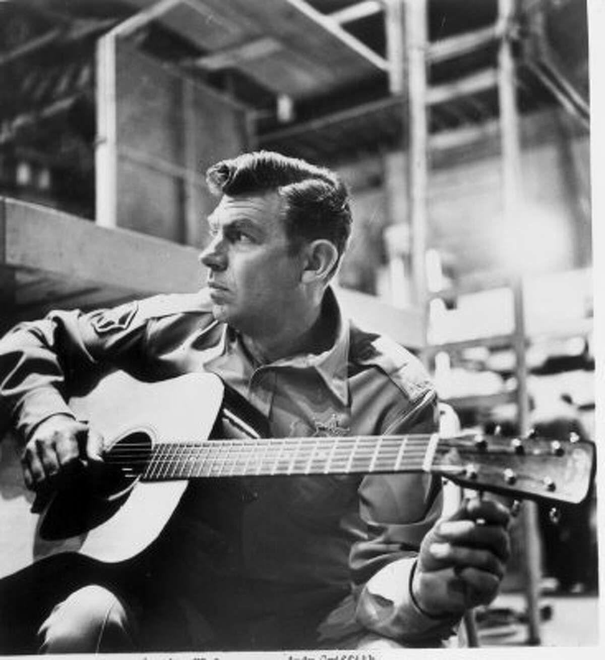 Andy Griffith in a May 1965 file photo. HOUCHRON CAPTION (06/21/1998): Andy Griffith, who occasionally played the guitar on his shows, had planned on a music career.