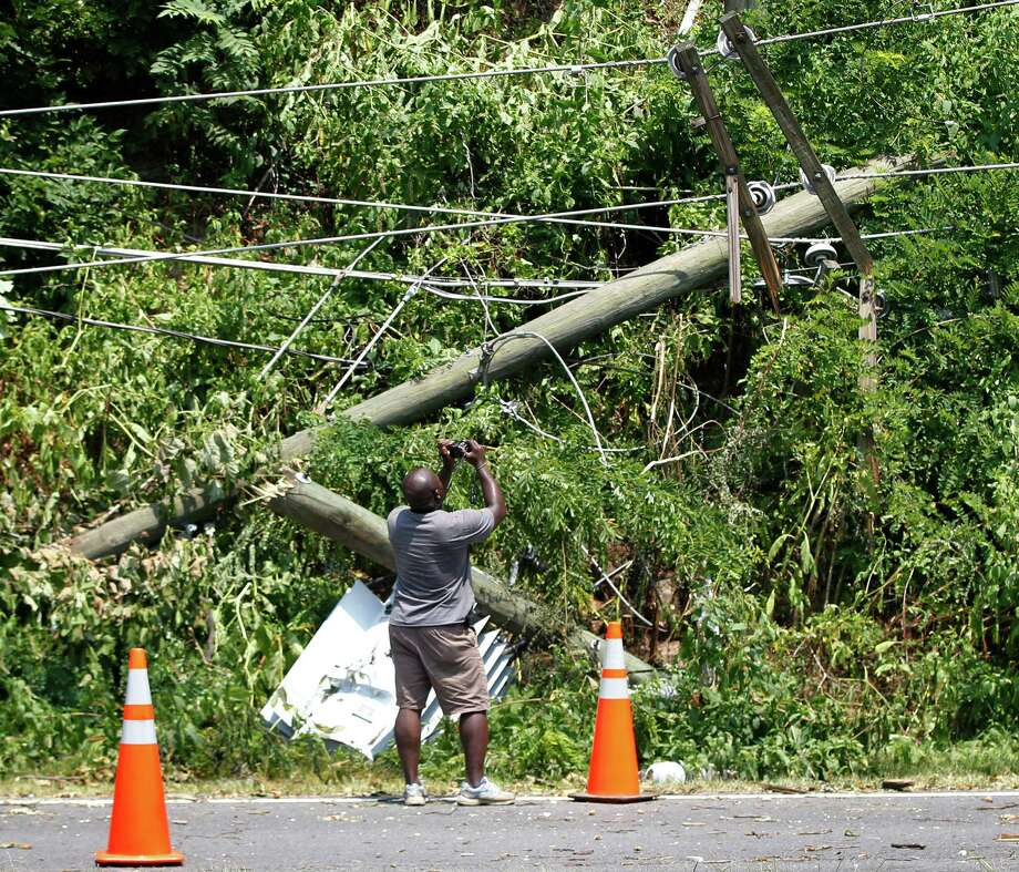 A downed utility pole and and electric transformer were left in the wake of storms last week in the  Northeast.   Photo: Pablo Martinez Monsivais, Associated Press