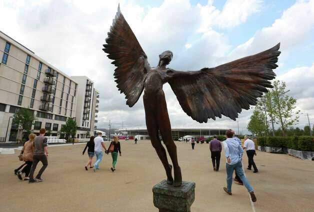 LONDON - JUNE 29: A statue of Icarus marks the way to the 5000 capacity temporary dining hall of the Olympic Village built for the London 2012 Olympic Games on June 29, 2012. in Stratford, east London. The village will accomodate up to 16,000 athletes and officials from more than 200 nations. Photo: WPA Pool, Getty Images / 2012 Getty Images