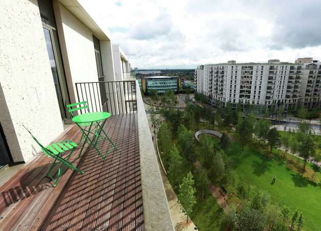 LONDON - JUNE 29: A balcony overlooks Victory Park in the Olympic Village, built for the London 2012 Olympic Games, on June 29, 2012 in Stratford, east London. The village will accomodate up to 16,000 athletes and officials from more than 200 nations. Photo: WPA Pool, Getty Images / 2012 Getty Images