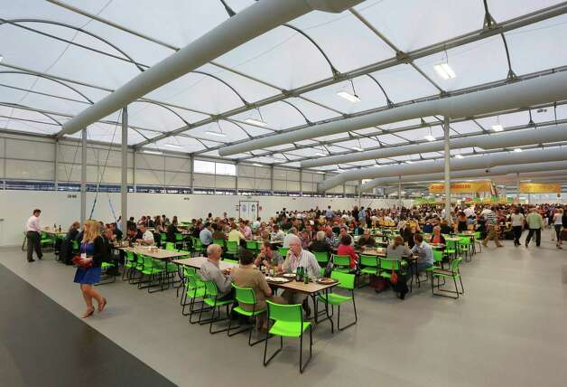 LONDON - JUNE 29:  Guests test the 5,000 capacity Olympic Village dining room, a temporary structure built for the London 2012 Olympic Games  on June 29, 2012. in Stratford, east London. The village will accomodate up to 16,000 athletes and officials from more than 200 nations. Photo: WPA Pool, Getty Images / 2012 Getty Images