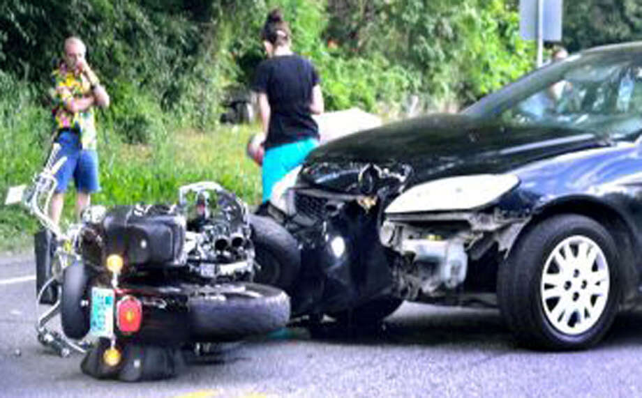 A motorcyclist was critically injured in this Mondaycollision on Park Lane (Route 202) in New Milford. July 2, 2012 Photo: Contributed Photo