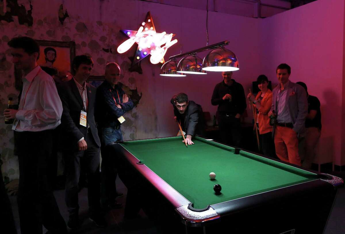 LONDON - JUNE 29: Visitors play pool in the Globe bar in the Olympic Village, built for the London 2012 Olympic Games, on June 29, 2012. in Stratford, east London. The village will accomodate up to 16,000 athletes and officials from more than 200 nations.