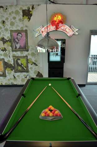 LONDON - JUNE 29:  In this handout image provided by LOCOG, a pool table sits ready for a game in the London 2012 Athletes Village Globe entertainment lounge, built for the London 2012 Olympic Games, on June 29, 2012. in Stratford, east London. The village will accomodate up to 16,000 athletes and officials from more than 200 nations. Photo: Handout, LOCOG Via Getty Images / 2012 LOCOG