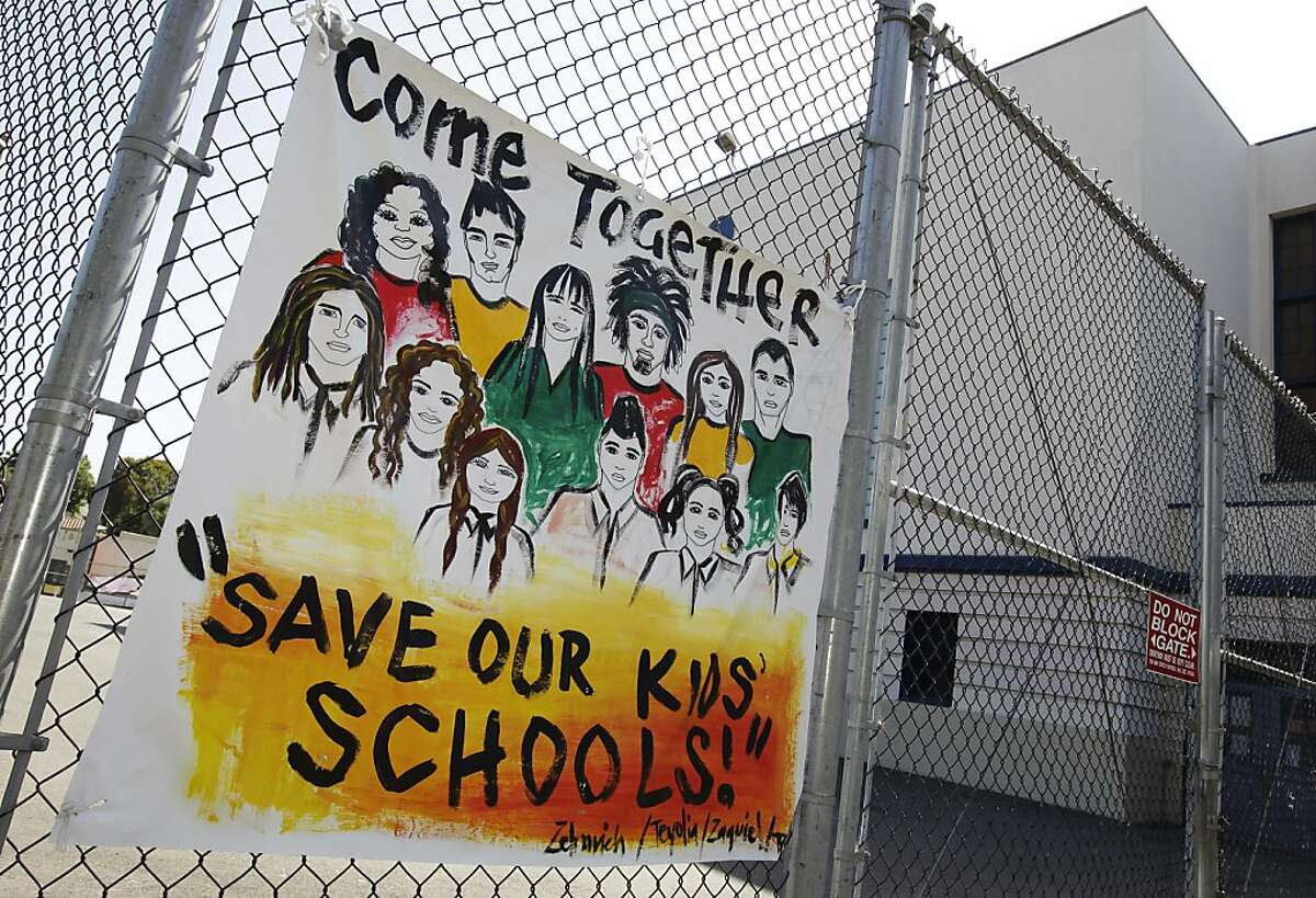 A sign is shown is posted inside of closed Lakeview Elementary School in Oakland, Calif., Tuesday, June 19, 2012 during a protest against school closures. Oakland school district police officers posted notices Monday, the fourth day of the protest, ordering the roughly dozen students, parents and activists on the grounds of Lakeview Elementary School to vacate the premises.
