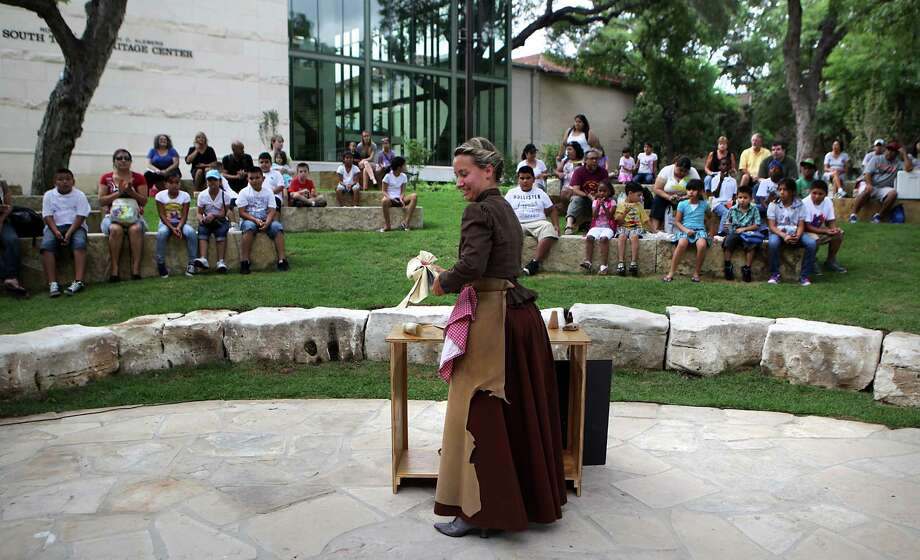 "Meggan Tjarks plays a widow who works for a  furniture maker in ""Longhorn Connections,"" a series of short plays and living period presentations at the Witte Museum Amphitheater.  Photo: Bob Owen, San Antonio Express-News / © 2012 San Antonio Express-News"