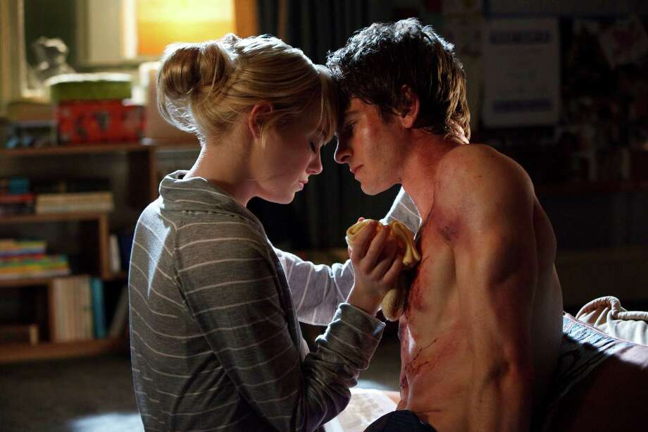 "In this film image released by Sony Pictures, Emma Stone, left, and Andrew Garfield are shown in a scene from ""The Amazing Spider-Man, set for release on July 3, 2012. Photo: AP"
