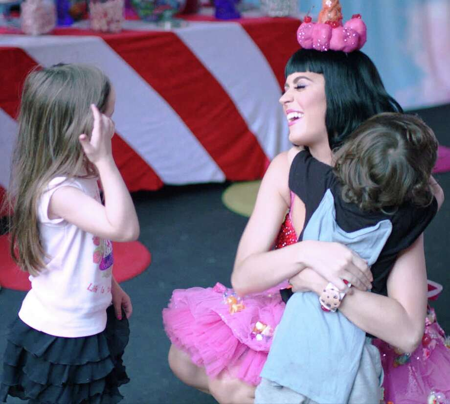"Katy Perry gets a hug from a young fan in a scene from the movie ""Katy Perry: Part of Me."" Photo: Paramount Pictures"