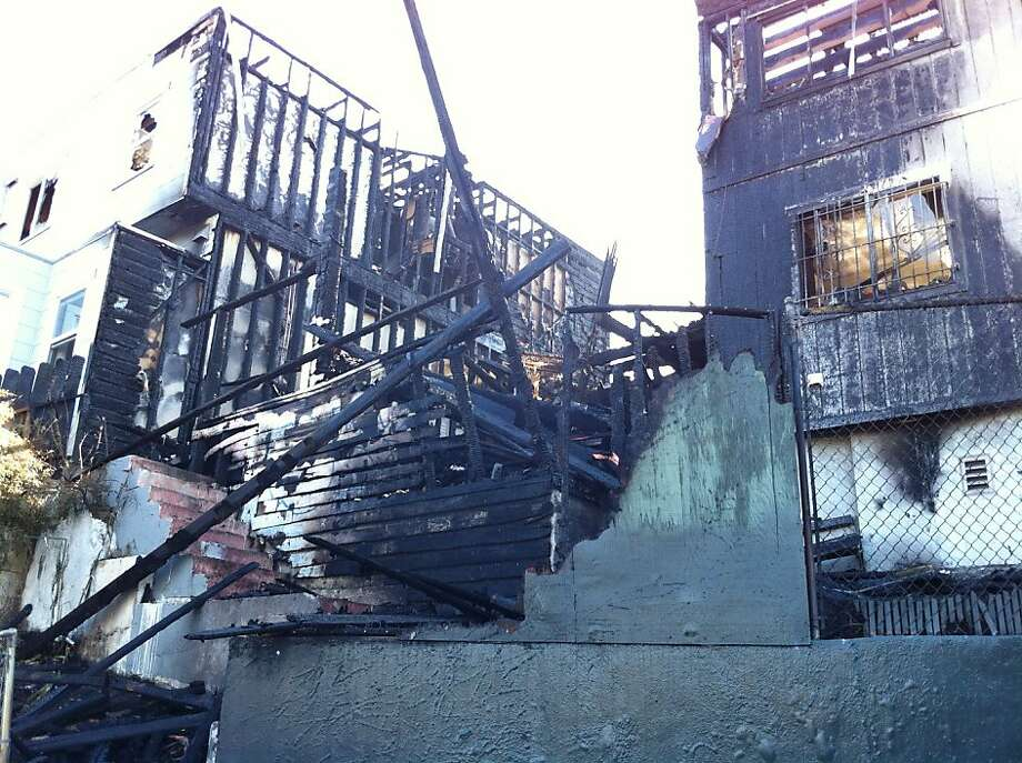 Police are investigation a four-alarm fire that destroyed a vacant building in San Francisco's Silver Terrace neighborhood early on Tuesday, July 3, 2012. Photo: Ellen Huet, The Chronicle