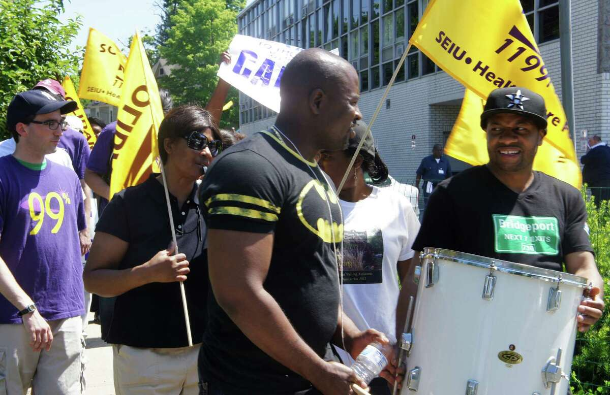 Striking union workers used drums and chants to rally picket lines Tuesday as New England Health Care Employees Union, District 1199, struck the Westport Health Care Center and four other state nursing homes owned by HealthBridge.