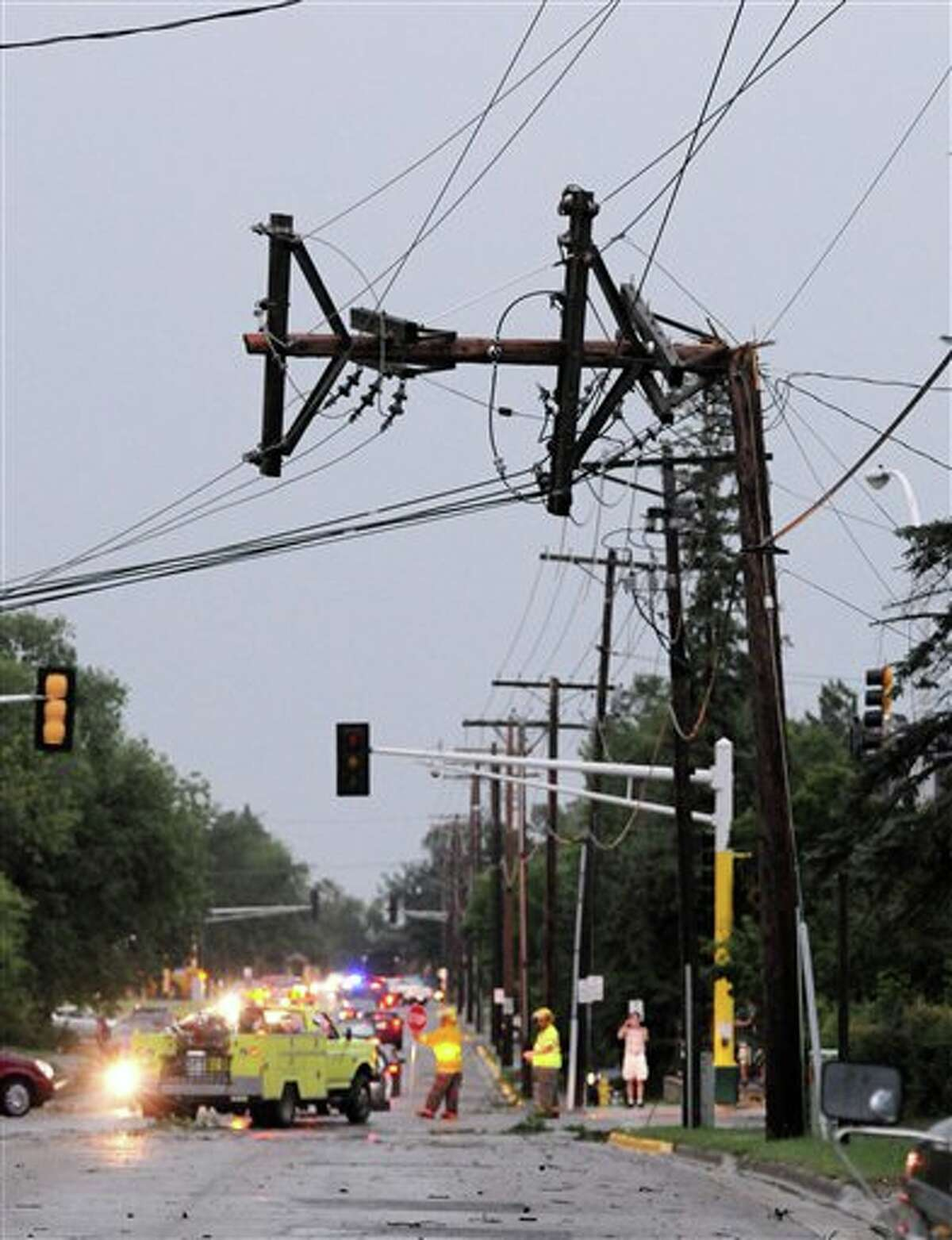 A power pole is bent after severe storms hit the Bemidji, Minn., area, knocking down thousands of trees and causing extensive damage to utility lines, leaving thousands of customers without power in the area. The county's emergency management assistant director, Christopher Muller, says utility crews are working on more than 100 spots where power lines are down and it may take well over 24 hours to restore service.