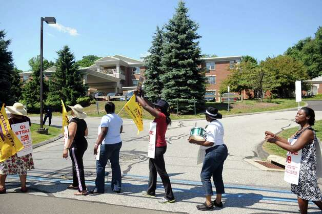 Union members picket outside Healthbridge's Long Ridge of Stamford nursing and rehabilitation facility in Stamford on Tuesday, July 3, 2012. Photo: Lindsay Niegelberg / Stamford Advocate