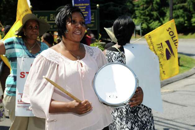 Certified Nursing Assistant Claudette Parks pickets outside Healthbridge's Long Ridge of Stamford nursing and rehabilitation facility in Stamford on Tuesday, July 3, 2012. Photo: Lindsay Niegelberg / Stamford Advocate