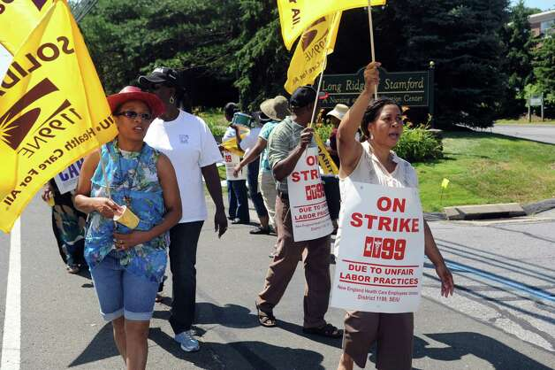 Union members pickets outside Healthbridge's Long Ridge of Stamford nursing and rehabilitation facility in Stamford on Tuesday, July 3, 2012. Photo: Lindsay Niegelberg / Stamford Advocate