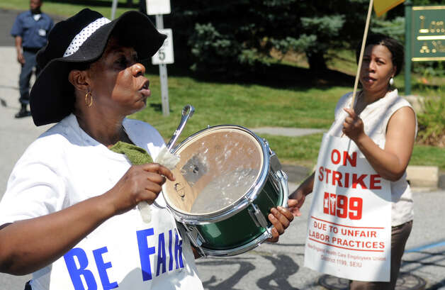 Certified Nursing Assistant Marie Solius pickets outside Healthbridge's Long Ridge of Stamford nursing and rehabilitation facility in Stamford on Tuesday, July 3, 2012. Photo: Lindsay Niegelberg / Stamford Advocate