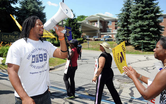 Union Organizer Jay Lewis pickets outside Healthbridge's Long Ridge of Stamford nursing and rehabilitation facility in Stamford on Tuesday, July 3, 2012. Photo: Lindsay Niegelberg / Stamford Advocate