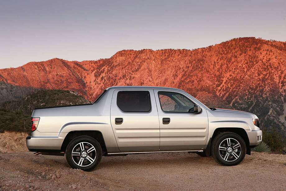 """Honda RidgelineWhat Forbes said: """"Though it's largely shunned by pickup purists, the car-based V6-powered Ridgeline is ideal for light-duty hauling and/or for active families who prefer to tote their recreational gear in a small pickup bed rather than soil the interiors of their SUVs.""""Source:Forbes Photo: Honda, Courtesy Of Honda / Honda"""