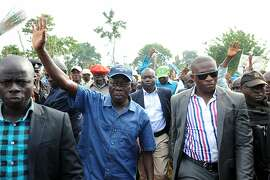 TO GO WITH AFP STORY BY BEN SIMON Incumbent Governor Adams Oshiomohole (C) arrives for a political rally at Emu in Edo State, on June 13, 2012. The fiery former President of Nigeria Labour Congress is campaigning for re-election in a state traditionally dominated by his rivals in the ruling People's Democratic Party (PDP).  Africa's most populous nation has been struggling to entrench credible democracy after years of military rule and sham votes, and 2011 presidential polls were seen as its fairest in nearly two decades despite major problems.  But as the Edo campaign has shown, elections can still be all-or-nothing affairs in the continent's largest oil producer, where the spoils of office often include control over vast patronage networks. AFP PHOTO/PIUS UTOMI EKPEIPIUS UTOMI EKPEI/AFP/GettyImages