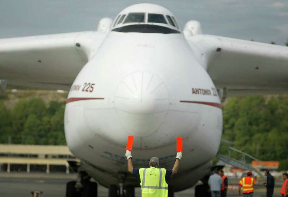 The Antonov 225, built in the 1980s, can carry a payload of more than  551,000 pounds. Its cargo volume capacity, however, is about 46,000  cubic feet, which is less than the Dreamlifter and Beluga. Here, the  An-225 lands at Boeing Field in Seattle on Aug. 31, 2007 to pick up four  777 engines for a delivery. Photo: Joshua Trujillo, Seattle Post-Intelligencer / Seattle Post-Intelligencer