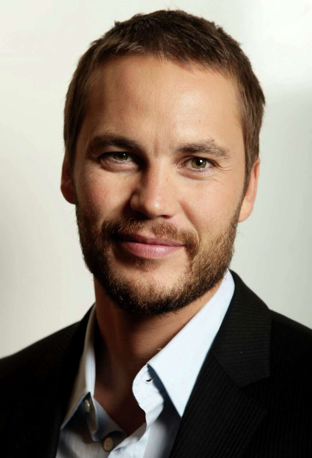 In this Friday, June 15, 2012 photo, actor, Taylor Kitsch, who appears in Oliver Stone's new film
