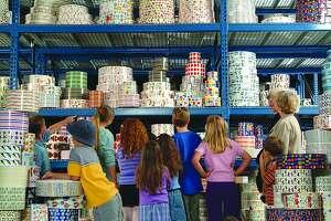 group of children tours Mrs. Grossman's sticker factory.