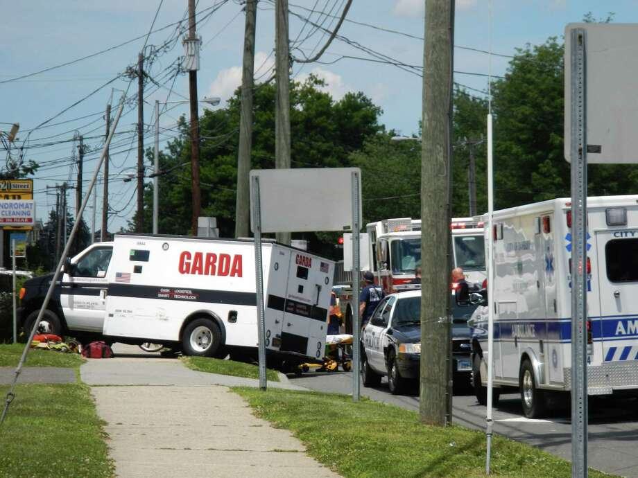 Two people were hospitalized with unspecified injuries after an armored car crashed Tuesday on Main Street in Danbury, fire officials said. Photo: Contributed Photo, Contributed Photo / Connecticut Post