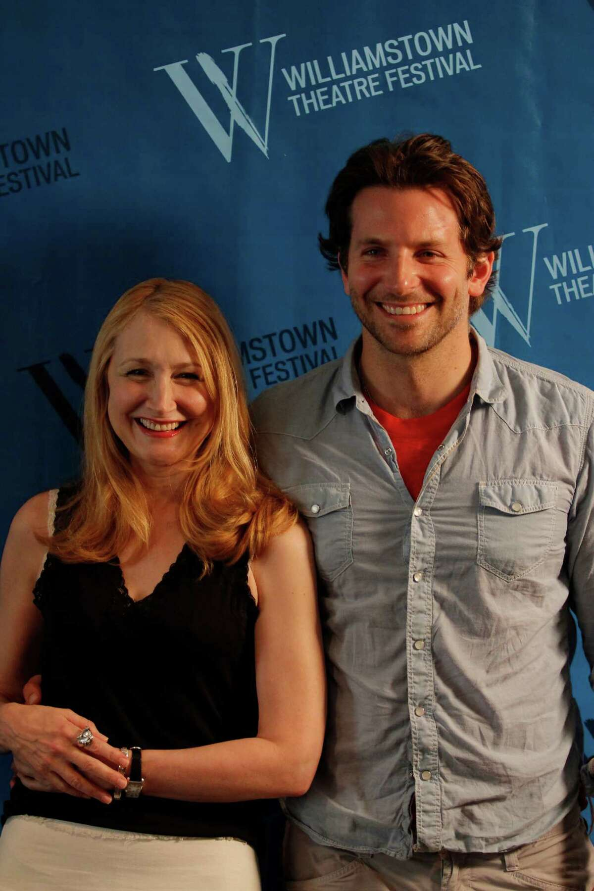 Actress Patricia Clarkson, left, and actor Bradley Cooper, right, pose for photos during a press availability for their roles in