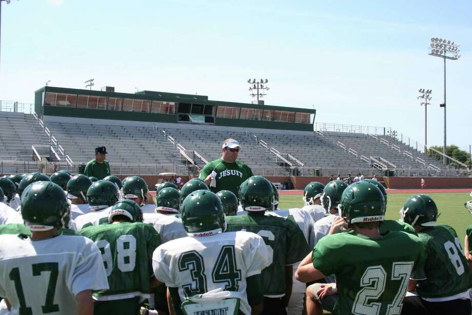 New Strake Jesuit football coach James Clancy puts the Crusaders through their paces during spring camp last May. Photo: Courtesy Strake Jesuit
