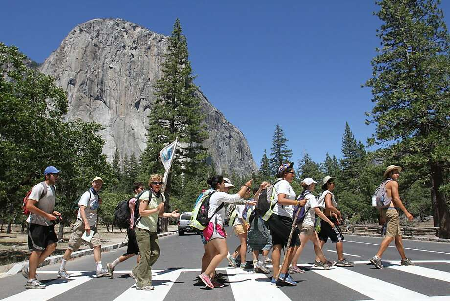 Students of Santa Clara University are joyful in their finally mile from San Francisco to Yosemite Valley (El Capitan in the background). Photo: Frederic Larson, Special To The San Francisco Chr