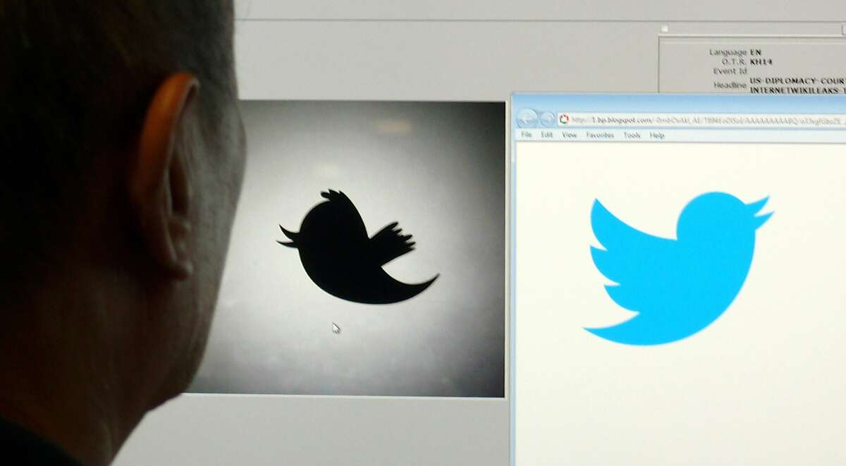 A man looks at a computer monitor showing the and old (L) and new (R) Twitter logos, June 6, 2012 in Washington DC. Twitter unveiled the new