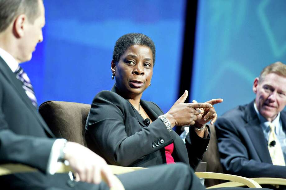 "Ursula Burns, chairwoman and chief executive officer of Norwalk-based Xerox Corp., center, speaks during a panel discussion with Gary Shapiro, left, president and CEO of the Consumer Electronics Association, and Alan Mulally, president and CEO of Ford Motor Co., at the 2012 International Consumer Electronics Show in Las Vegas in January. Xerox has further diversified its holdings by buying Lateral Design, an ""e-discovery"" technology provider. Daniel Acker/Bloomberg. Photo: Contributed Photo / Stamford Advocate Contributed"