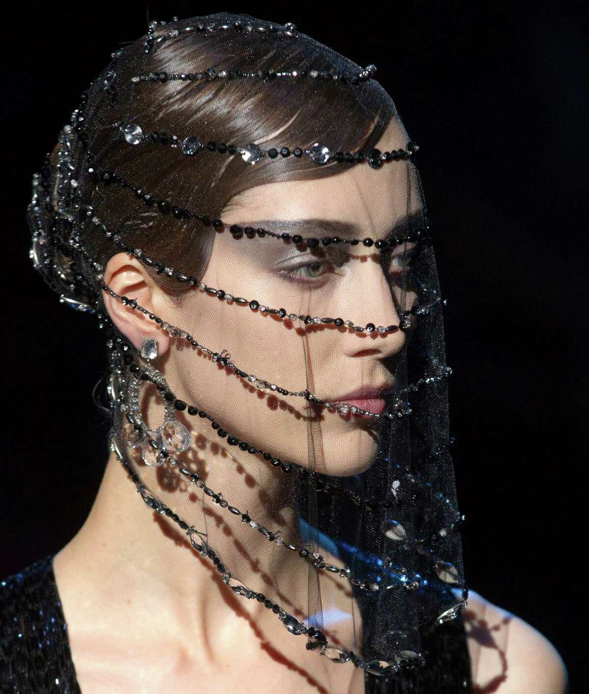 A model wears a creation by Italian designer Giorgio Armani as part of his presentation for Women's Fall Winter 2013 haute couture fashion collection, in Paris, France, Tuesday, July 3, 2012.