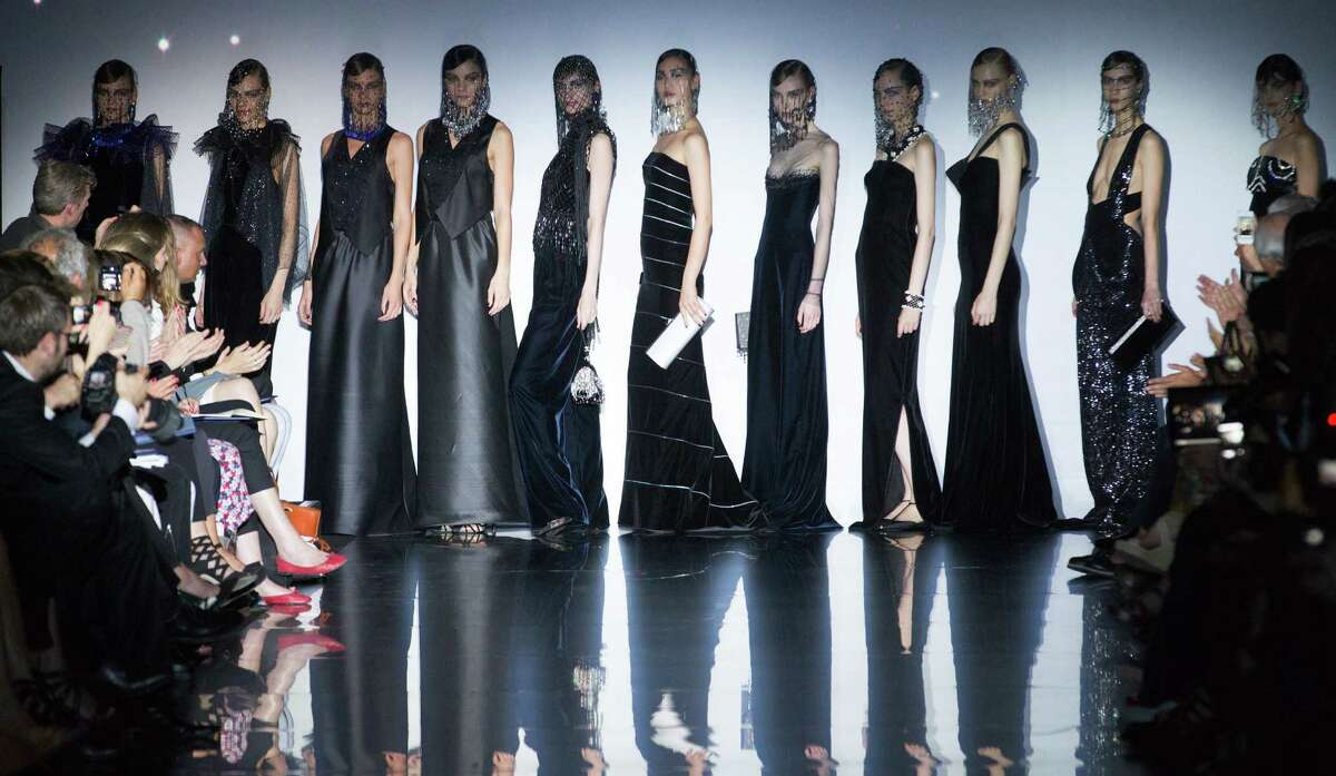 Models wear creations by Italian designer Giorgio Armani as part of his presentation for Women's Fall Winter 2013 haute couture fashion collection, in Paris, France, Tuesday, July 3, 2012.