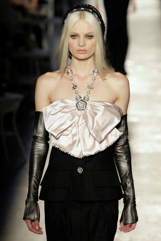 A model wears a creation of Chanel by fashion designer Karl Lagerfeld during his Women's Fall Winter 2013 haute couture fashion collection in Paris, France, Tuesday, July 3, 2012. Photo: Francois Mori, AP / AP