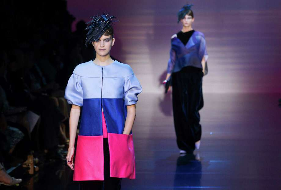 Models wear creations by Italian designer Giorgio Armani as part of his presentation for Women's Fall Winter 2013 haute couture fashion collection, in Paris, France, Tuesday, July 3, 2012. Photo: Jacques Brinon, AP / AP