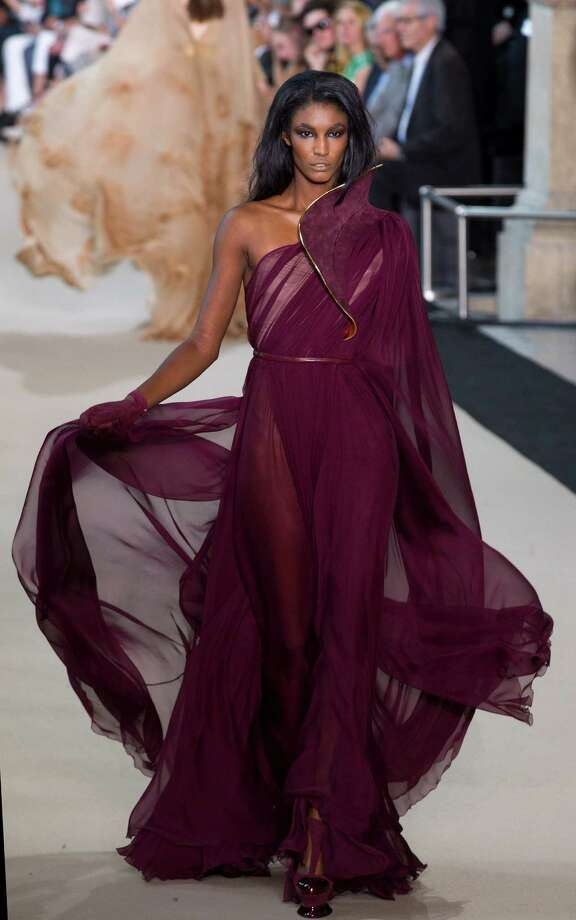 A model wears a creation by French designer Stephane Rolland as part of his presentation for Women's Fall Winter 2013 haute couture fashion collection, in Paris, France, Tuesday, July 3, 2012. Photo: Jacques Brinon, AP / AP