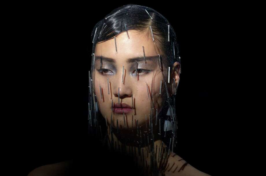 A model wears a creation by Italian designer Giorgio Armani as part of his presentation for Women's Fall Winter 2013 haute couture fashion collection, in Paris, France, Tuesday, July 3, 2012. Photo: Jacques Brinon, AP / AP