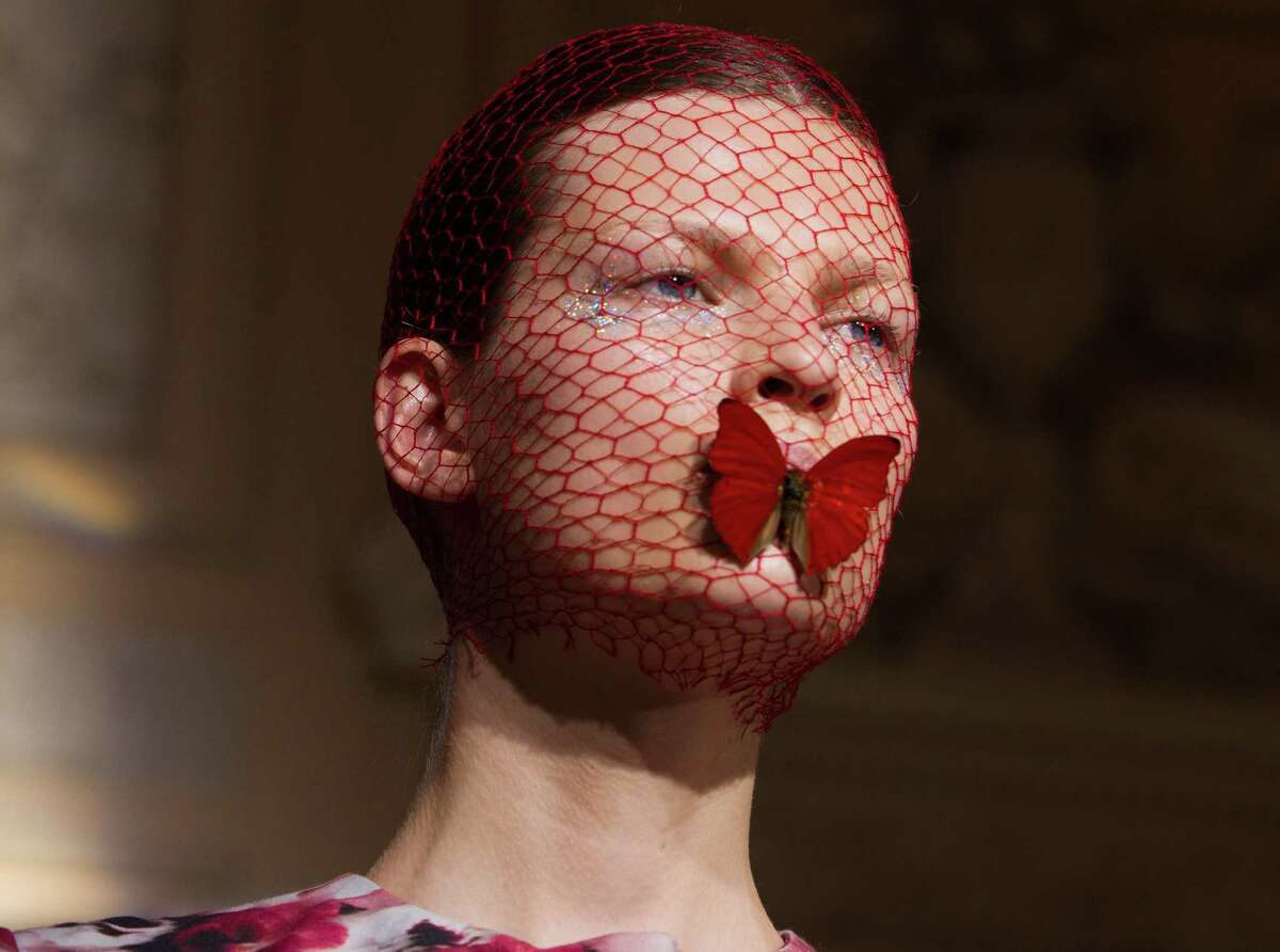 A model wears a creation by Italian designer Giambattista Valli as part of his presentation for Women's Fall Winter 2013 haute couture fashion collection, for the fashion house in Paris, France, Monday, July 2, 2012.