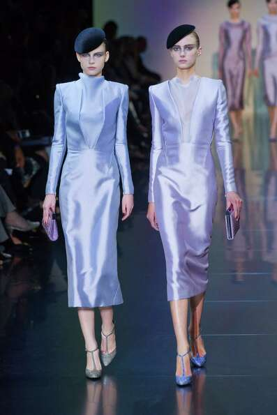 Models wear creations by Italian designer Giorgio Armani as part of his presentation for Women's Fal